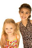 Cute young girls wearing swimsuits looking forward Royalty Free Stock Photos