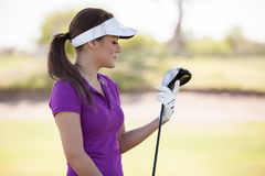 Cute young golfer ready to play Royalty Free Stock Images