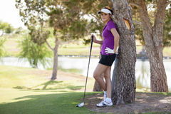 Cute young golfer taking a break Royalty Free Stock Image