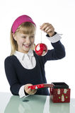 Cute young gril holding a Christmas bauble Stock Photography