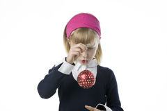 Cute young gril holding a Christmas bauble Stock Images