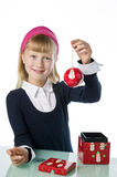 Cute young gril holding a Christmas bauble Royalty Free Stock Photography