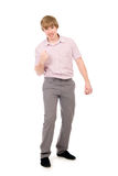 Cute young guy clenching his fist in triumph Royalty Free Stock Image
