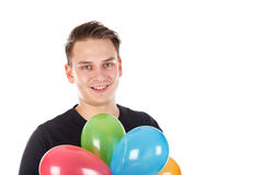 Cute young guy with colorful balloons Royalty Free Stock Image