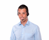 Cute young guy speaking with earphone royalty free stock image