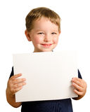 Cute young happy preschooler boy holding up sign Royalty Free Stock Image