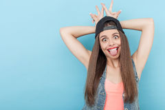 Cute young hipster girl is making fun Stock Images