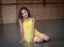 Cute young hispanic dancer in a dance studio. Cute young dancer portrait smiling at her dance class stock photo