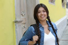 Cute young hispanic female smiling outdoors.  royalty free stock image