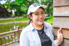Cute young innocent asian teen smile portrait. Holiday travel waring hat Royalty Free Stock Photo