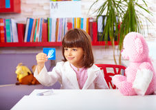 Cute young kid playing a doctor in office Stock Photo