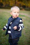Cute young kid playing outdoors. Stock Images