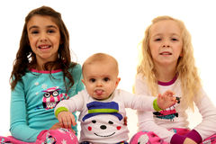 Cute young kids wearing winter pajamas with a funny expression Stock Photos