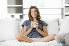 Cute young lady with a cup of coffee Stock Images