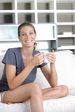Cute young lady with a cup of coffee Royalty Free Stock Image
