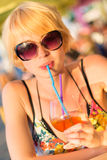 Cute young lady  drinking cocktail. Stock Photos