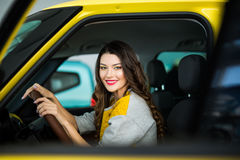 Cute young lady happy driving car Stock Image