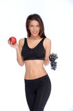 Cute young lady holding red apple while isolated on white Royalty Free Stock Photography