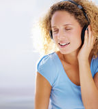 Cute young lady listening to romantic music Royalty Free Stock Images