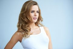 Cute young lady looking her left Royalty Free Stock Photos