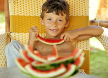 Cute young little boy with watermelon crustes Stock Images