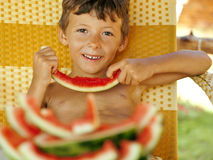 Cute young little boy with watermelon crustes Royalty Free Stock Photography