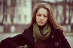 Cute young long-haired woman grieves royalty free stock image