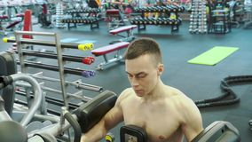 Cute Young Male Bodybuilder Engaged With An Exercise Machine To Train Shoulders Muscles. Healthy Lifestyle And Sports Concept stock video footage