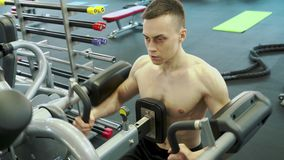 Cute Young Male Bodybuilder Engaged With An Exercise Machine To Train Shoulders Muscles. Healthy Lifestyle And Sports Concept stock video