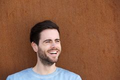 Cute young man with beard smiling Royalty Free Stock Images