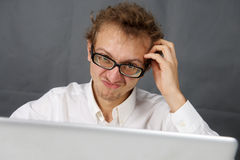 Cute young man with laptop. Royalty Free Stock Photography