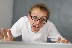 Cute young man with laptop. Royalty Free Stock Image