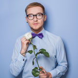 Cute young man with rose. Date, birthday, Valentine Stock Image