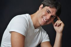 Cute young man smiling. This picture represents a cute young man smiling Royalty Free Stock Photo