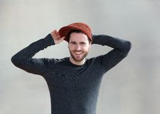 Cute young man smiling with hat Stock Images
