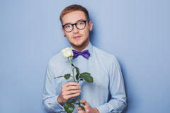 Cute young men with flower. Date, birthday, Valentine Stock Photos
