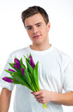 Cute young men give the flowers Royalty Free Stock Image