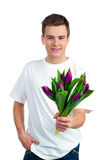 Cute young men give the flowers Royalty Free Stock Images
