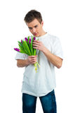 Cute young men give the flowers Stock Image