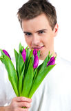 Cute young men give the flowers Stock Photo