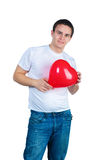 Cute young menl with a red heart Stock Images