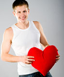 Cute young menl with a red heart Royalty Free Stock Images