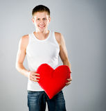 Cute young menl with a red heart Stock Image