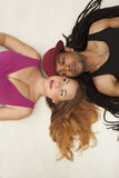 Cute young mixed couple on the floor Stock Images