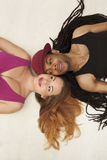 Cute young mixed couple on the floor Royalty Free Stock Image