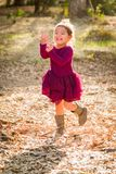 Cute Young Mixed Race Baby Girl Playing Outdoors. Cute Young Mixed Race Baby Girl Running and Playing Outdoors stock photography
