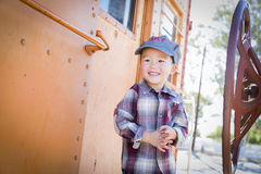 Cute Young Mixed Race Boy Having Fun on Railroad Car Royalty Free Stock Photos