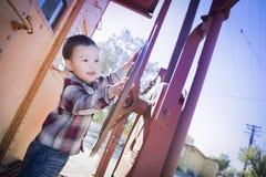 Cute Young Mixed Race Boy Having Fun on Railroad Car Stock Image