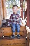 Cute Young Mixed Race Boy Having Fun on Railroad Car Stock Photos