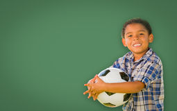 Cute Young Mixed Race Boy Holding Soccer Ball In Front of Blank Stock Images